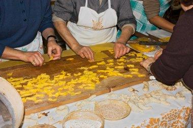Women making pasta