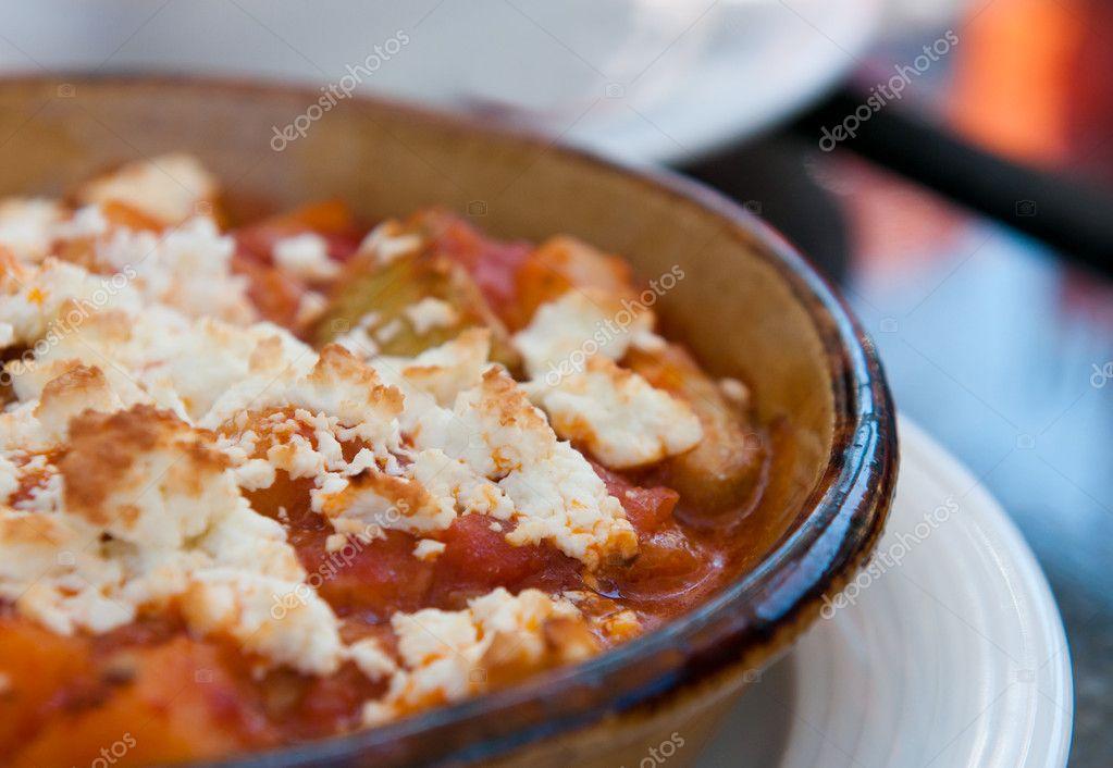 Griechische Küche mit Käse und Tomaten — Stockfoto © mpalis #9825850