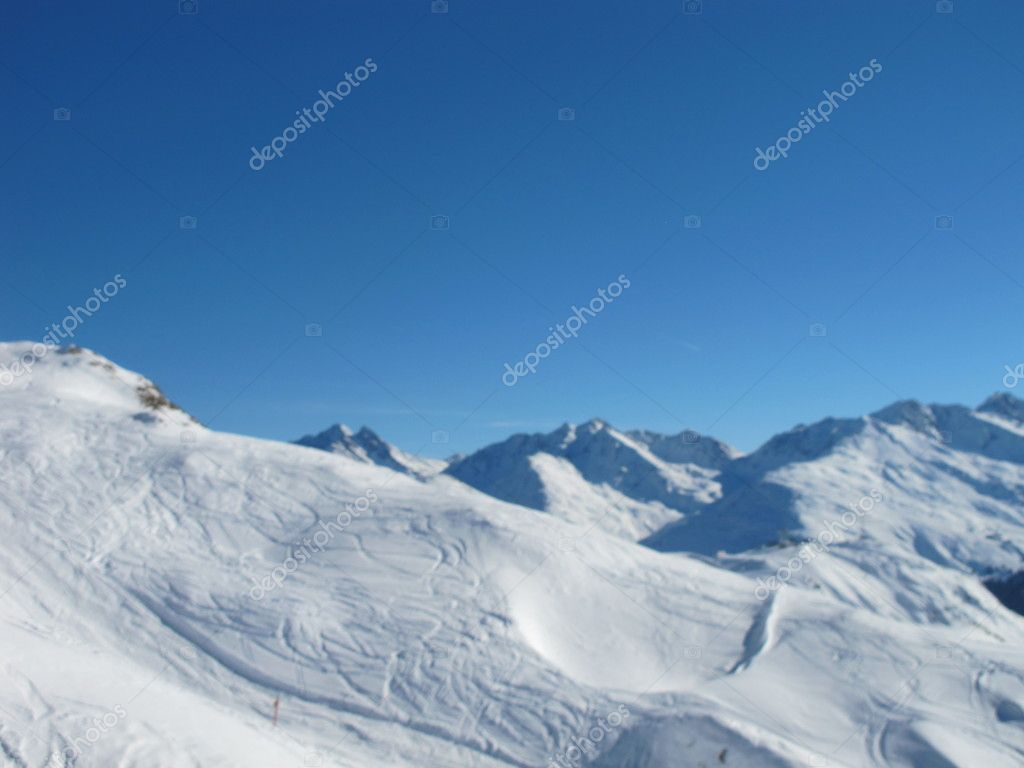 Ski slopes and mountain panorama on sunny day