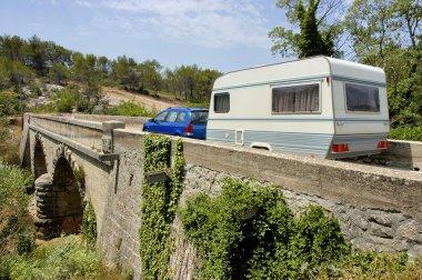 Caravan at a bridge