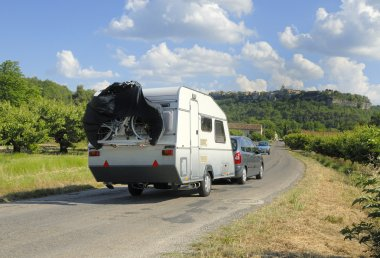 Car with caravan on its way