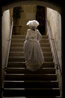 Victorian lady in castle stairs. 1900 Style.
