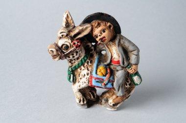 Drunk gypsy mounted ceramic donkey.