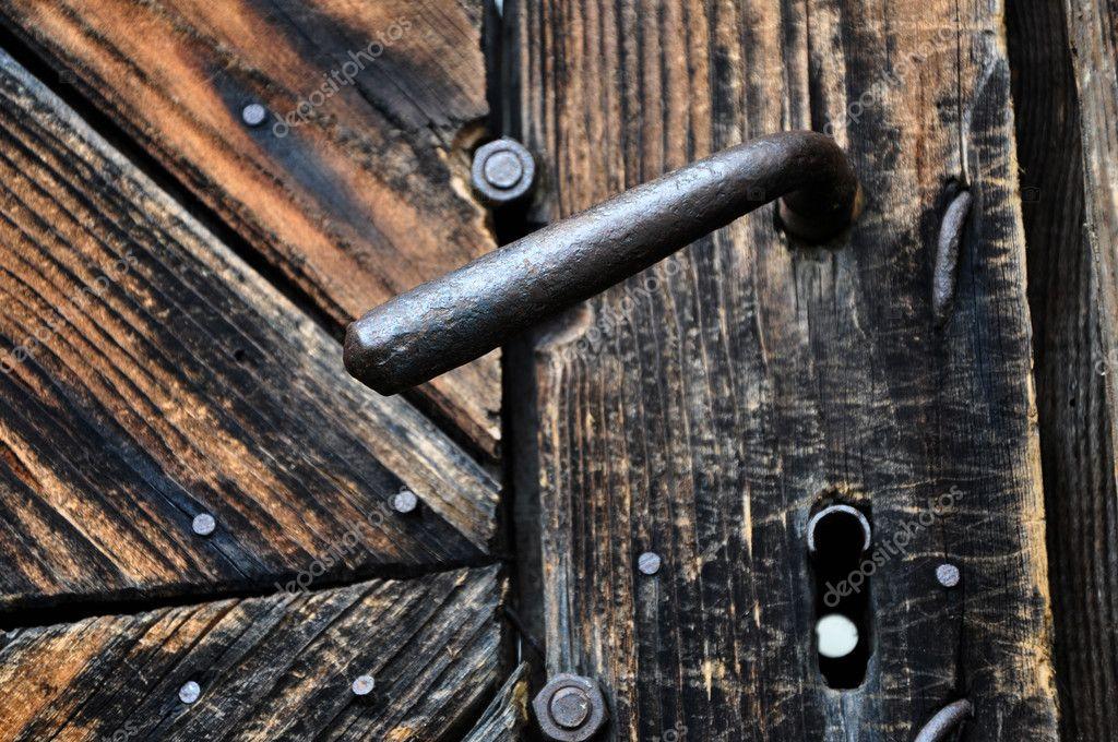 A very old door handle on a wooden door — Stock Photo © salajean ...