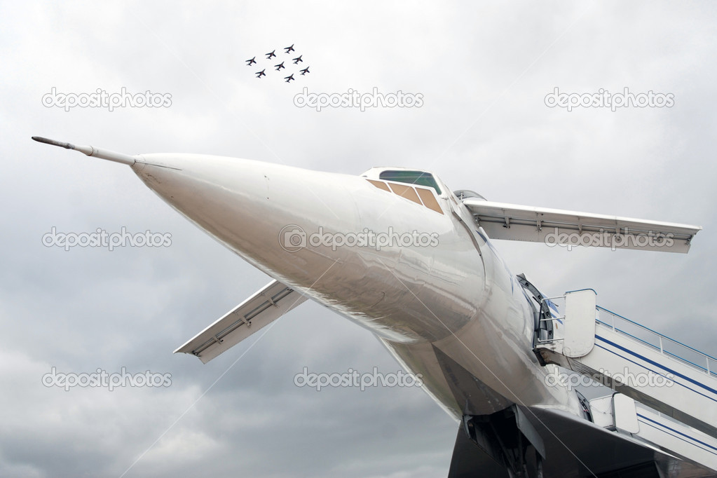 Russian airplane TU-144 and eight planes in sky