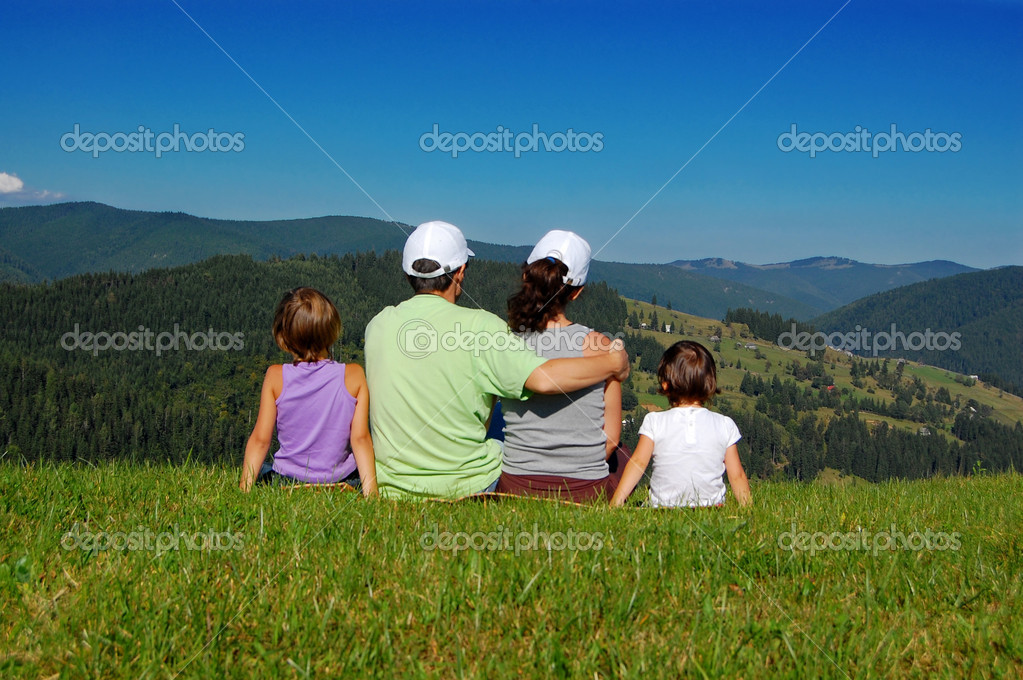 Active family of four on their vacation in mountains