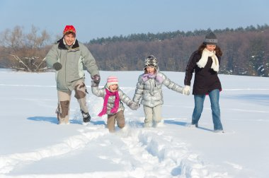 Happy family winter fun outdoors
