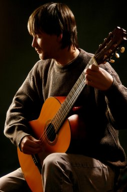 Classical guitarist guitar acoustic playing.