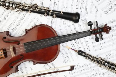 Classical musical instruments with music sheet.