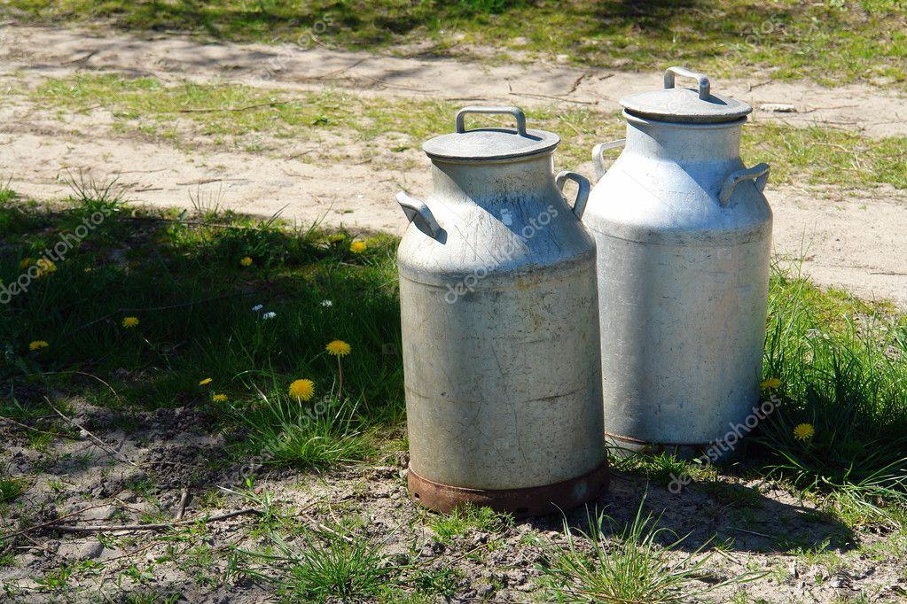 Milk cans jugs in a farm