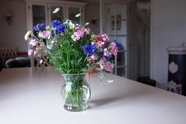 Beautiful spring summer flowers in a glass vase