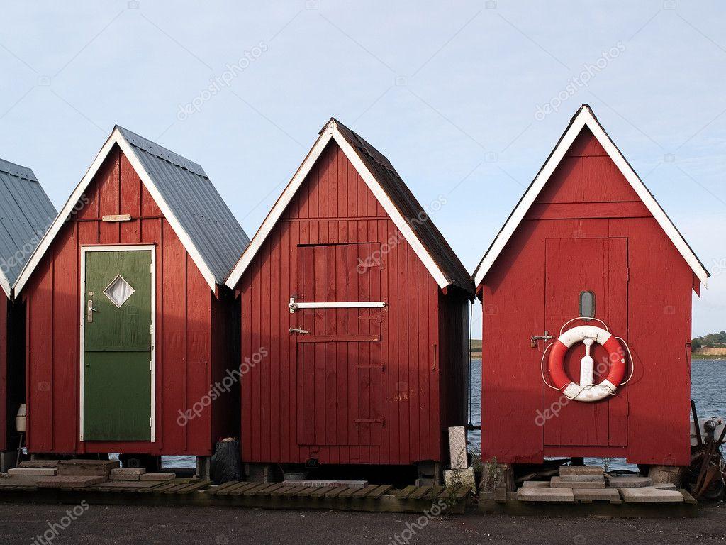 Beautiful red fishing huts on the coast