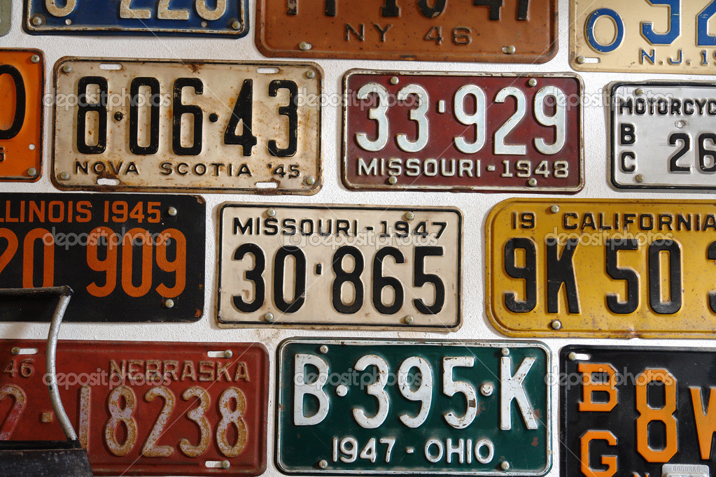 Vintage American cars number plates — Stock Photo © ronyzmbow #9122105