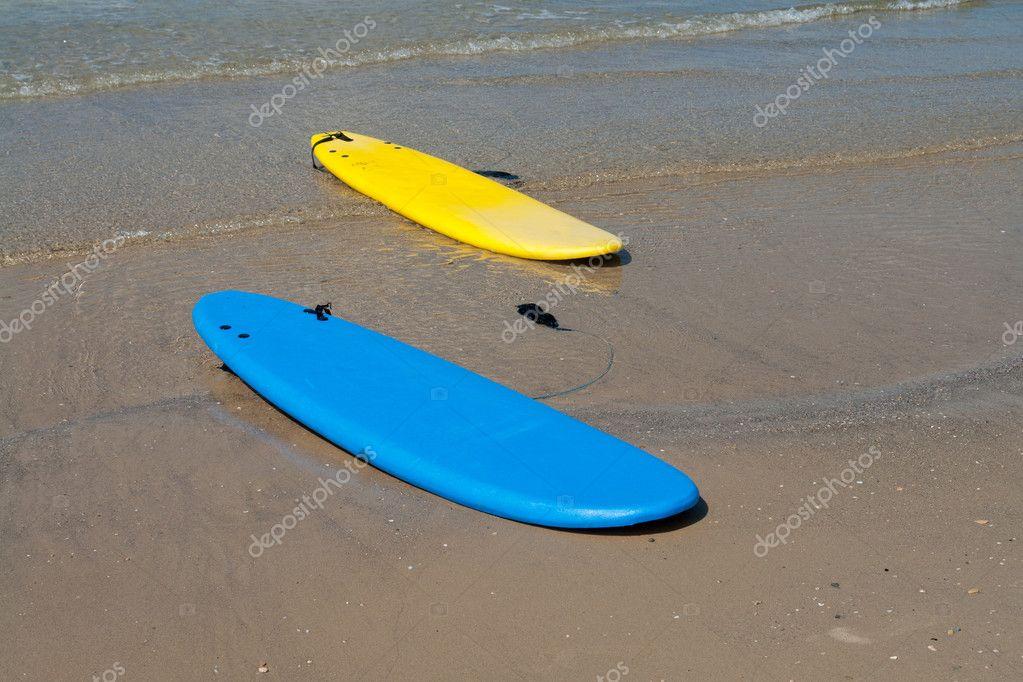 Surf boards on a sandy beach