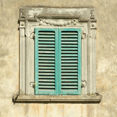 Beautiful old window with green shutters