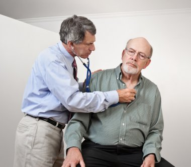 Doctor or Nurse Listens to Older Man's Heart and Lungs