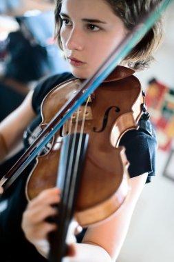 Young Woman Playing Violin Closeup