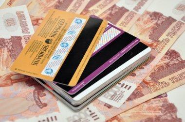 Plastic cards on money