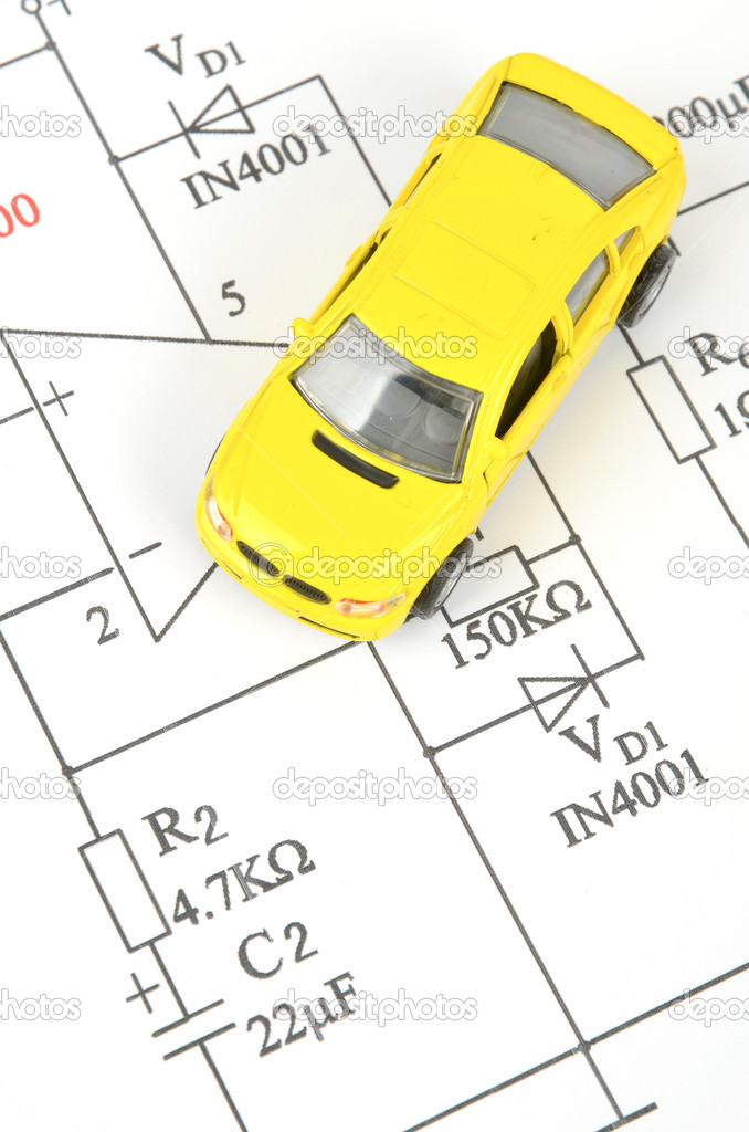 circuit diagram and a yellow toy car — photo by anaken2012