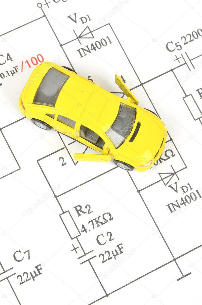 Schaltung-Diagramm und Spielzeug-Auto — Stockfoto © anaken2012 #10028579
