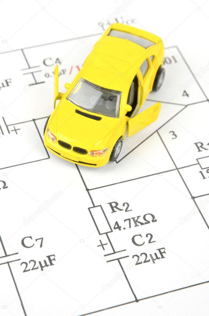 Schaltung-Diagramm und Spielzeug-Auto — Stockfoto © anaken2012 #10028604