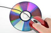 DVD a červené počítačová myš