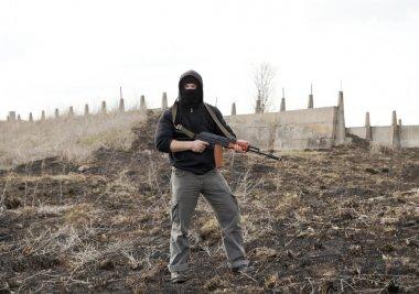 Man in mask with gun
