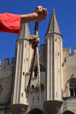 Executioner with a noose in front of the Palace of the Popes
