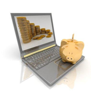 Gold piggy bank and laptop