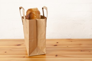 Brown Loaf In A Paper Carrier Bag