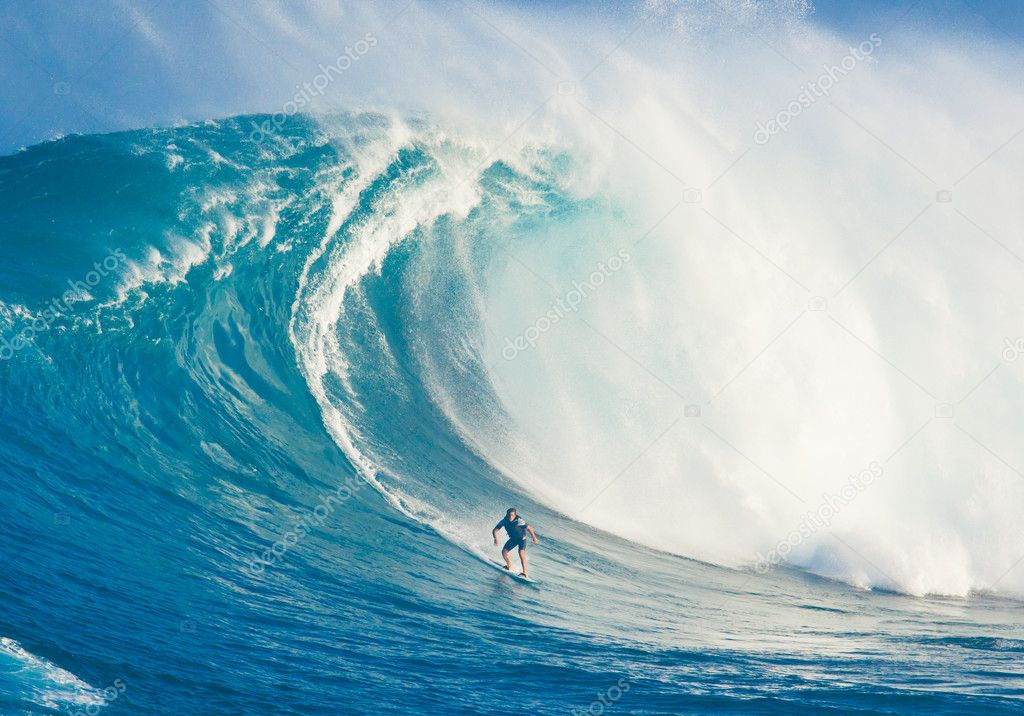 MAUI, HI - MARCH 13: Professional surfer Billy Kemper rides a gi