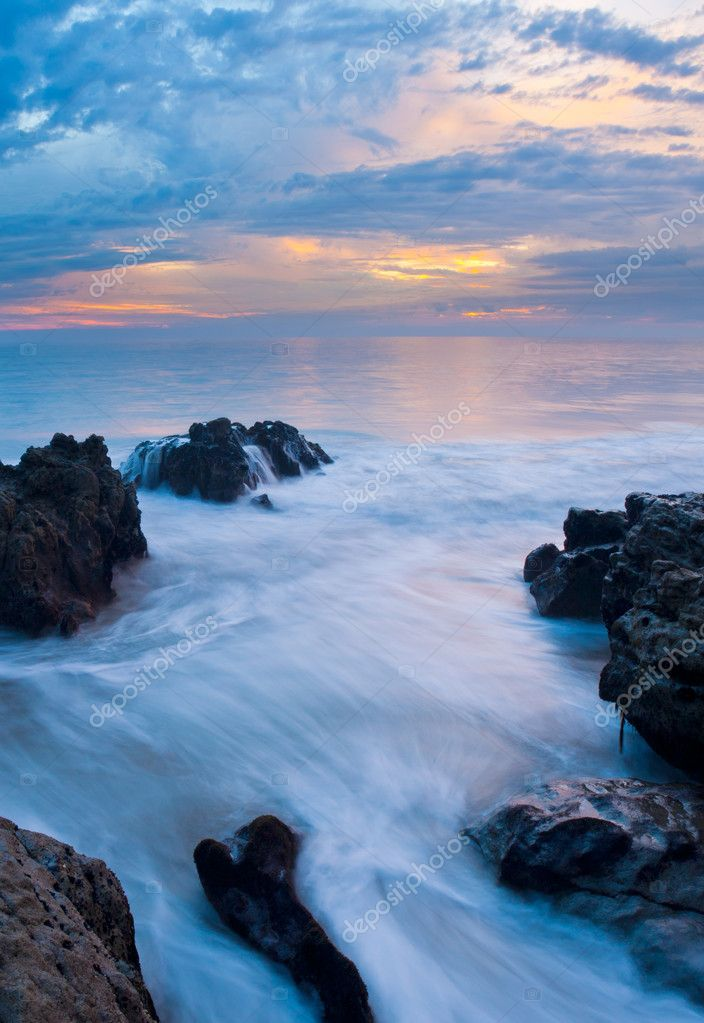 Beautiful Seascape, Ocean and Rocks at Sunset