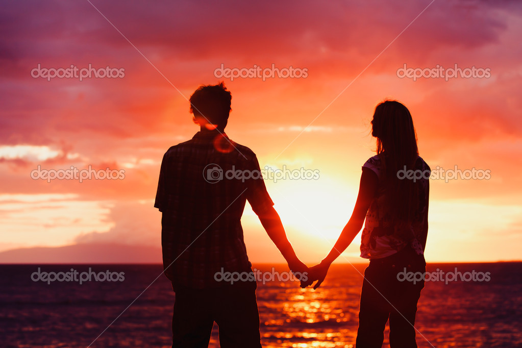 Silhouette of Young Romantic Couple at Sunset