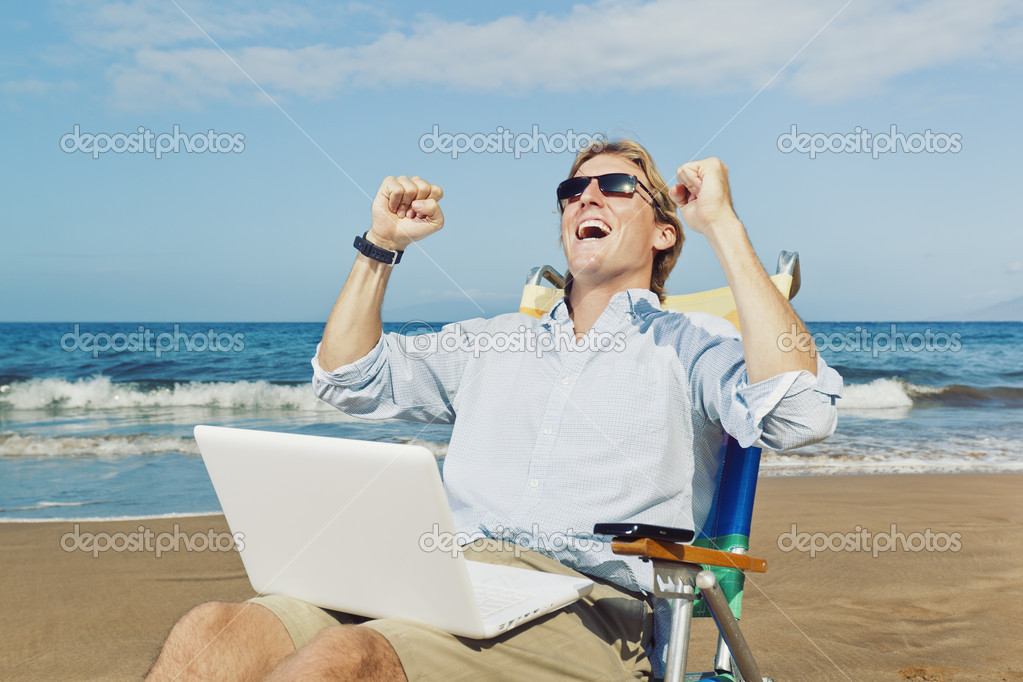 Young Attractive Man Celebrating Success, Working on Computer at