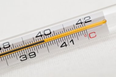 Closeup of a thermometer showing high fever