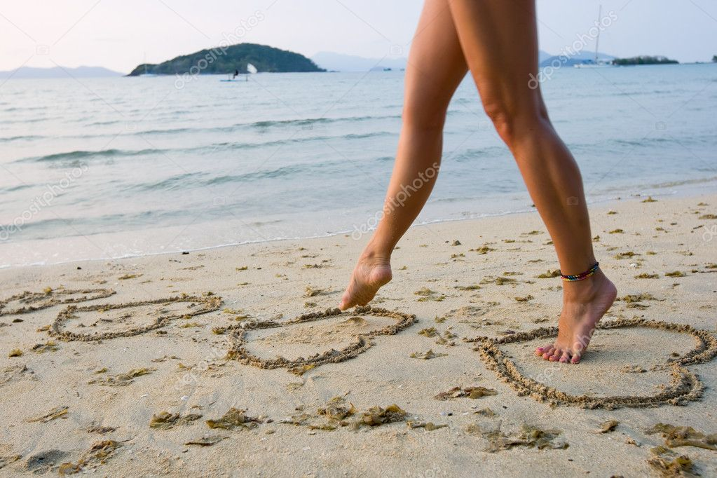 Womans legs on beach