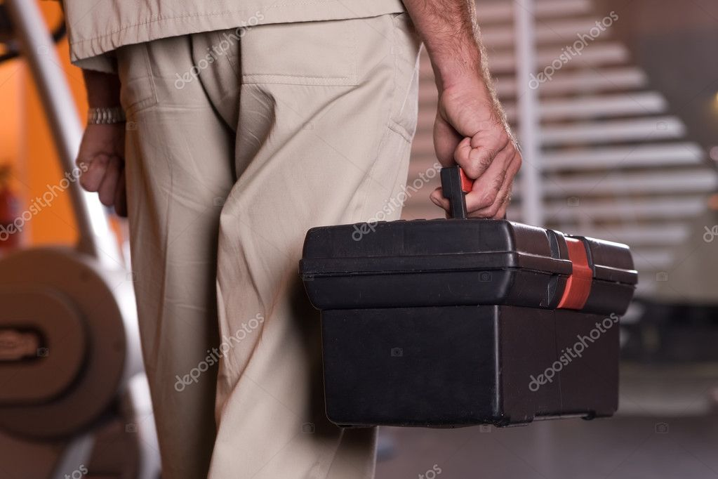 Man holding tool box