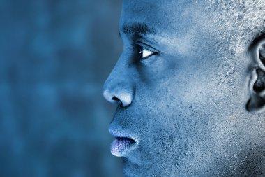 Profile of a blue toned man