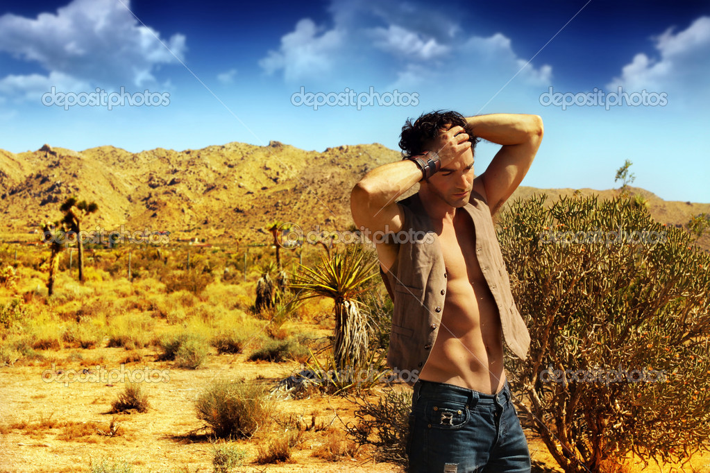 Sexy guy in desert