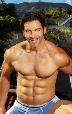 Happy shirtless muscular man