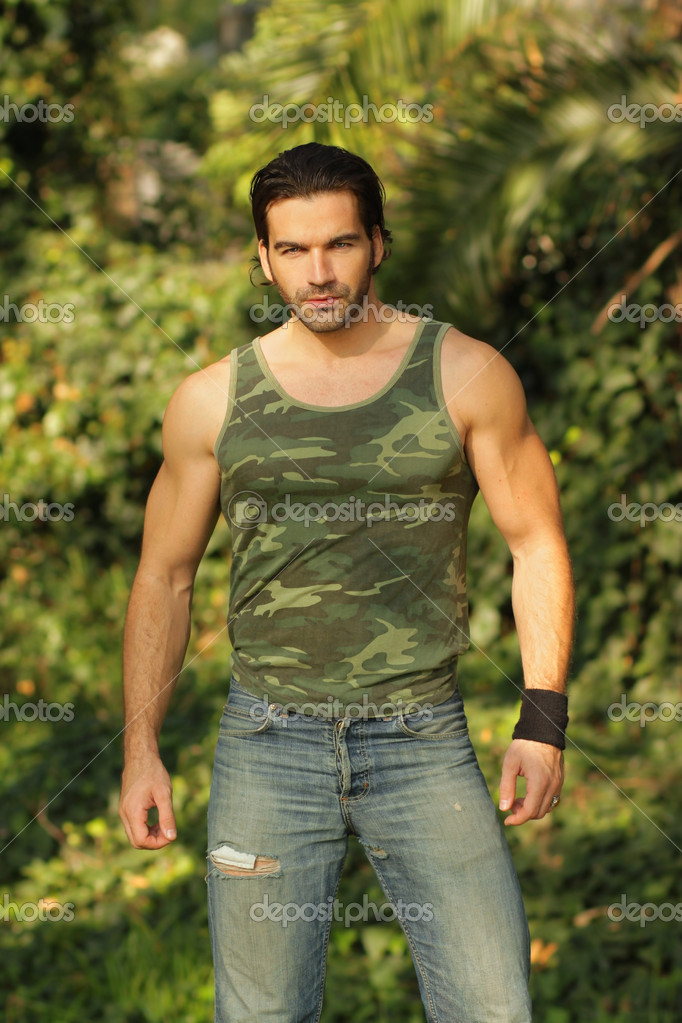 Portrait of a muscular young man in beautiful natural setting