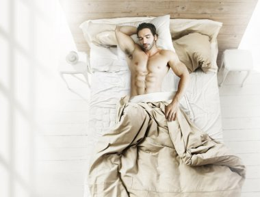Man in bed from above
