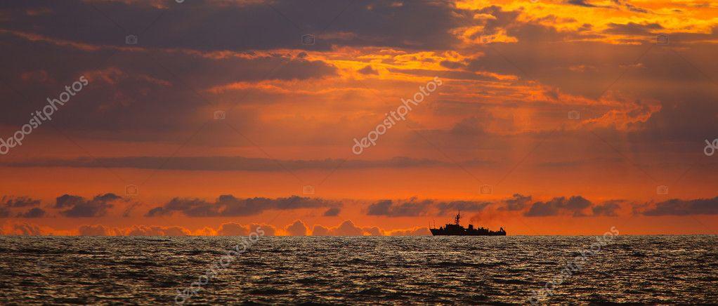 Navy ship on sunset