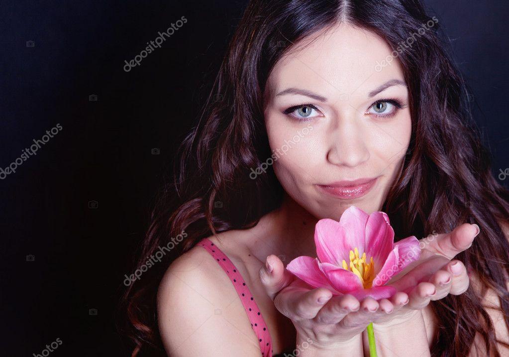 Girl with tulip flower in hands