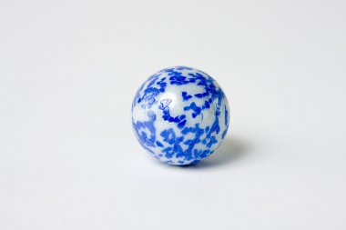 Blue and white speckled glass marble