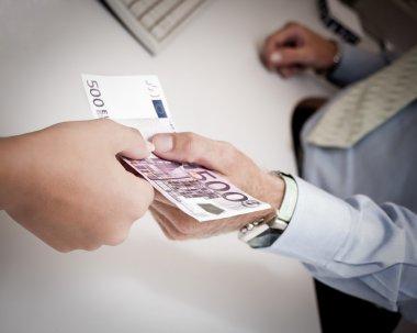 Hands passing money
