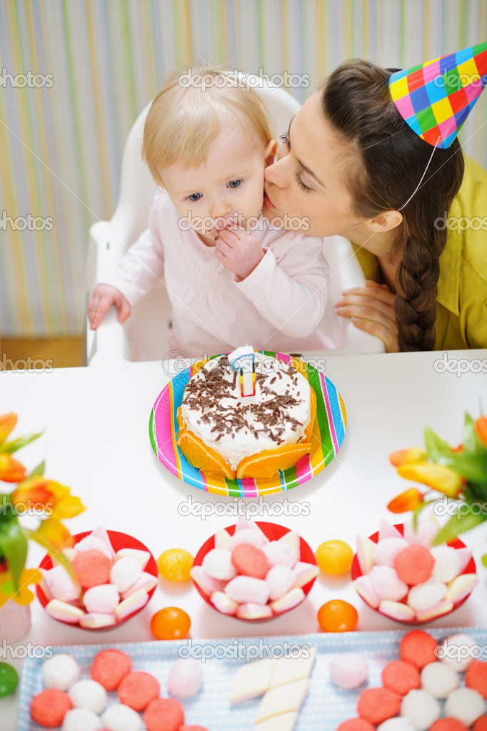 Super Mother Kissing Baby Eating Birthday Cake Stock Photo Funny Birthday Cards Online Hendilapandamsfinfo