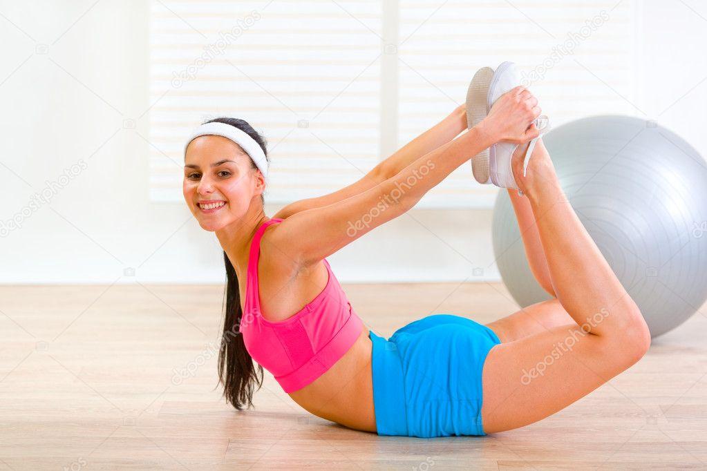 Smiling flexible girl making gymnastics exercise — Stock ...