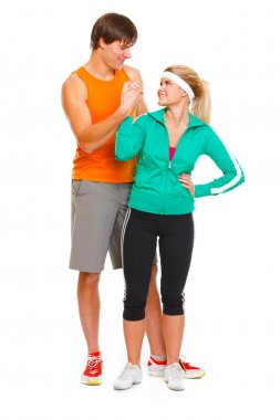 Happy male athlete and fitness young woman handshaking isolated