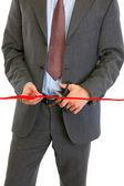 Fényképek Közelkép a üzletember vágó piros szalag